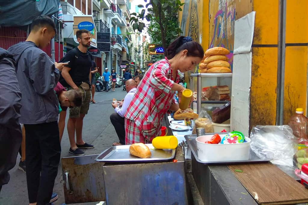 A lady serving Banh Mi on the streets of Hanoi. Photo credit: Miroslaw Podyma