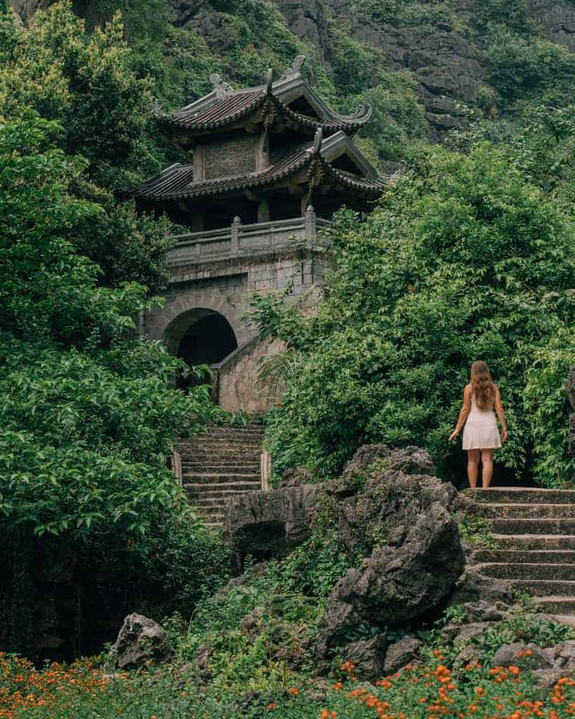Girl looks up at temple in Ninh Binh