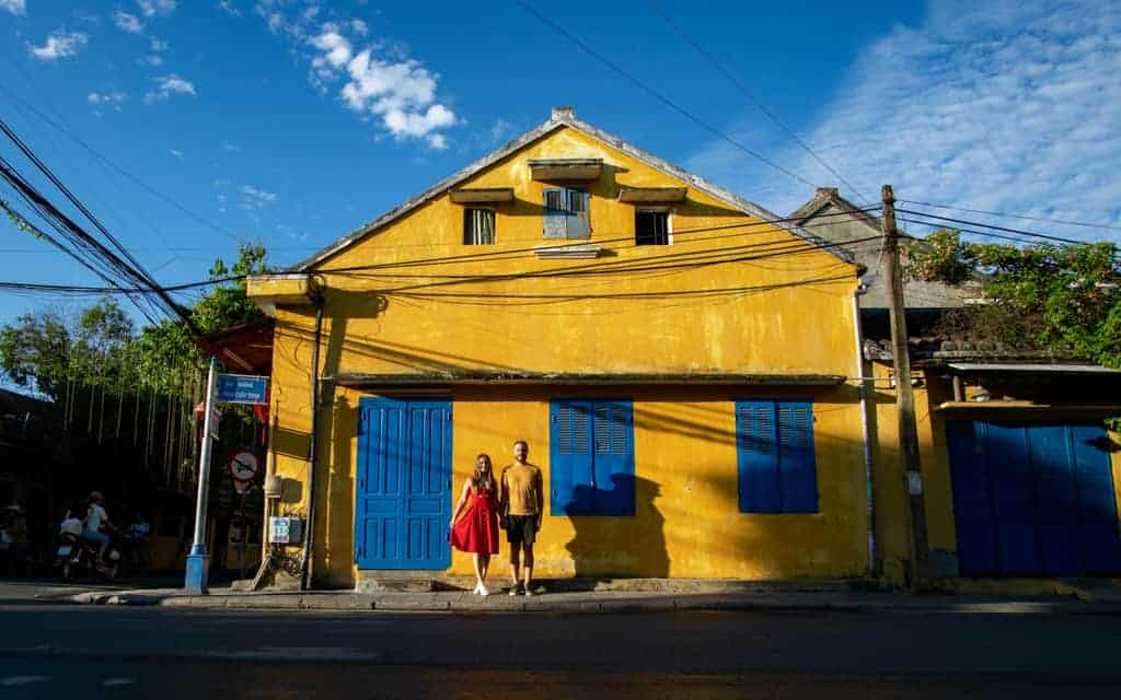 Couple posing outside building in Vietnam