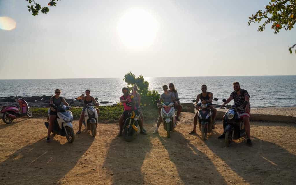 Backpackers on motorbikes