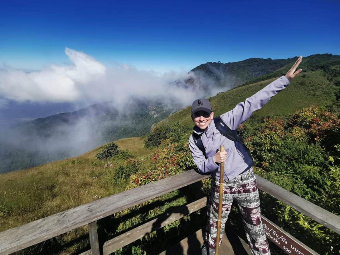 A girl hiking in a pair of harem elephant pants.