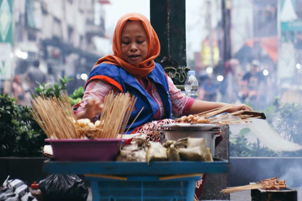 Lady cooks food in Indonesia