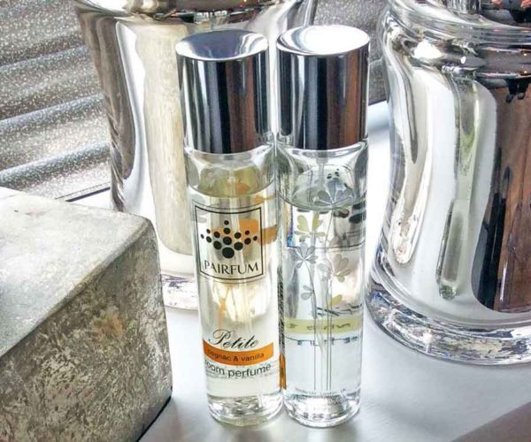Pairfum Petite Perfume Room Spray On Window Sill In Modern Livingroom With Chrome Decor