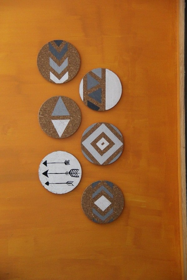 Six pieces of Cork Board Wall Art hung on an orange wall