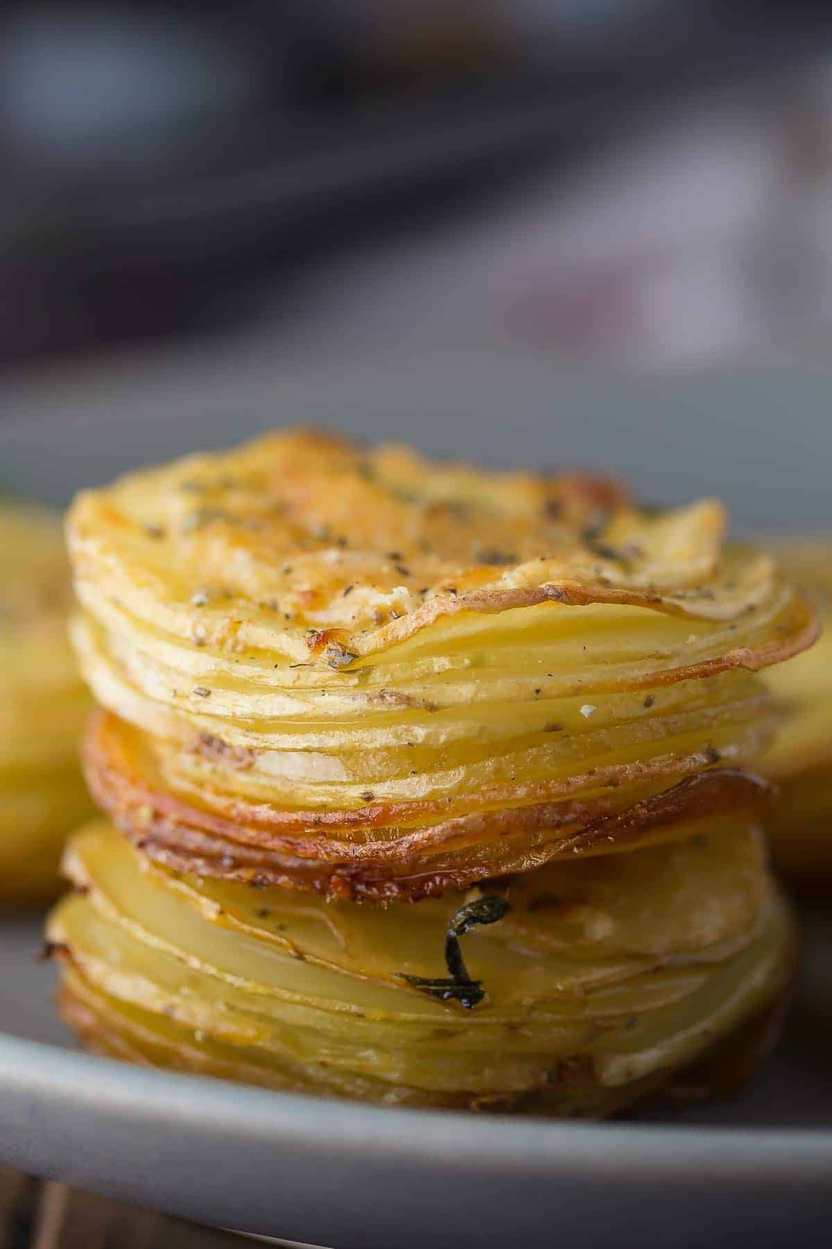 side angle and close up view of potato stack on plate. Christmas dinner sides