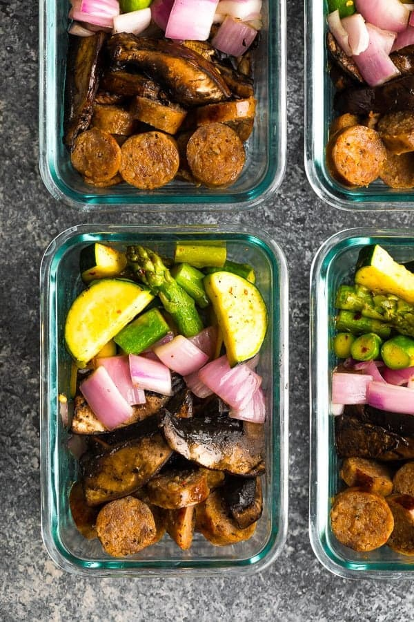 overhead shot of four glass meal prep containers with low carb breakfast bowls