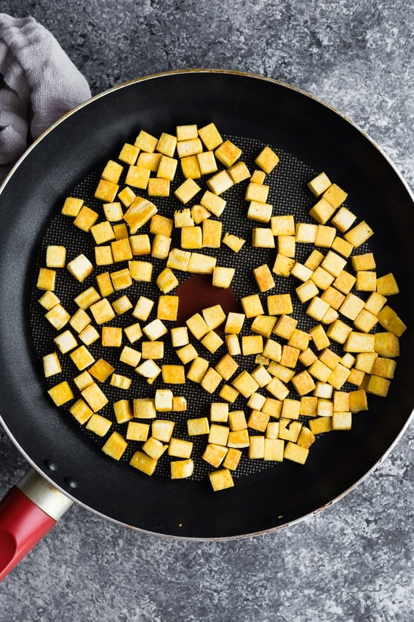overhead view of tofu cooking in a frying pan