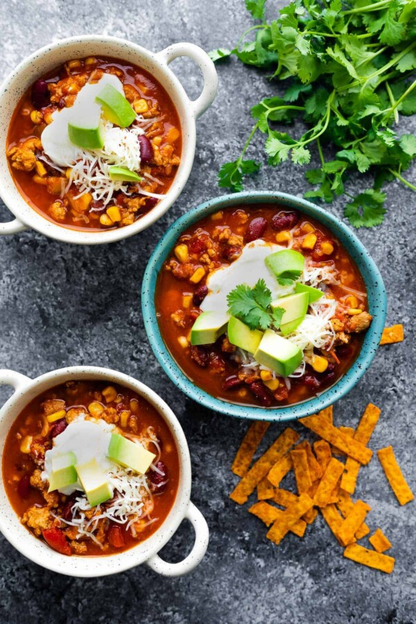 overhead view of three bowls of instant pot turkey chili