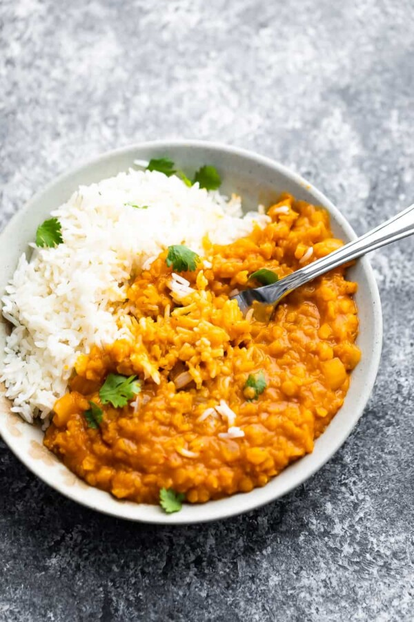 thai lentil curry mixed with rice in a bowl