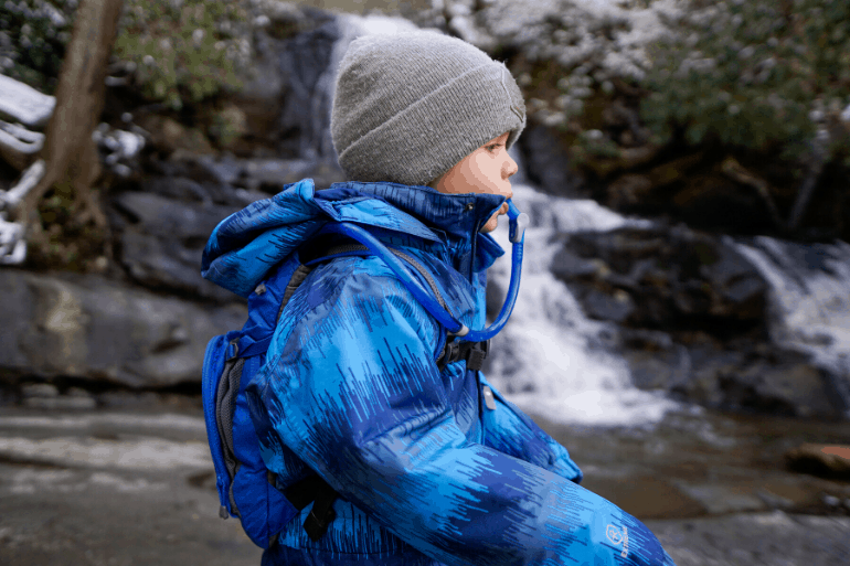 Kid drinking from Camelbak Mini MULE hydration backpack