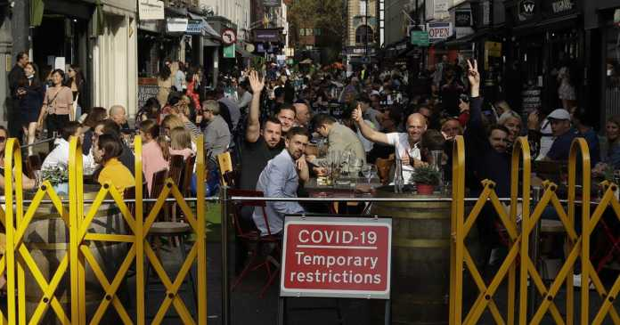 'Perilous turning point': U.K. tightens restrictions as virus surges