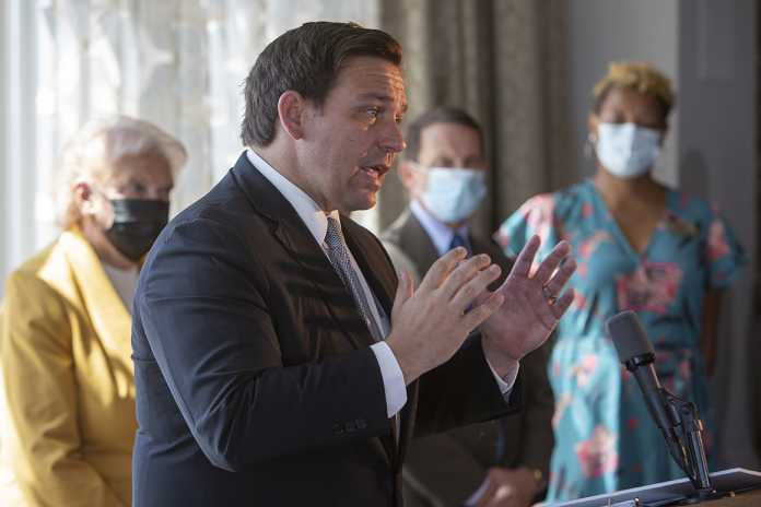 DeSantis flings open Florida in Trump's campaign for normalcy