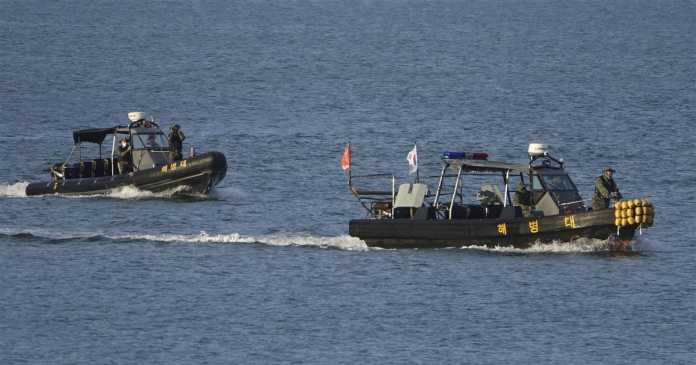 North Korea warns of naval tensions during search for slain South Korean