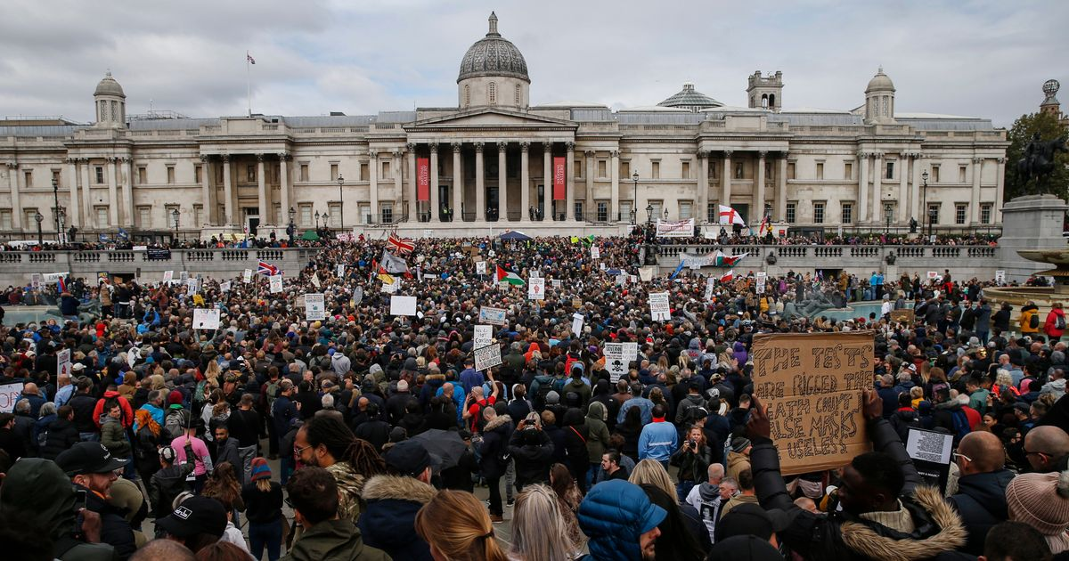 Thousands of anti-mask protesters gather in London and clash with police