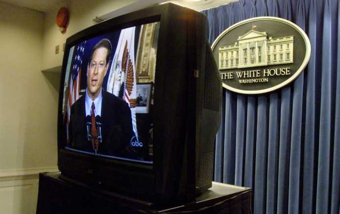 A television at the White House shows Al Gore giving his concession speech