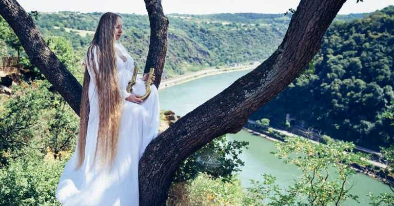 5ft 8in woman grows her hair so long that it's 2 inches longer than she is