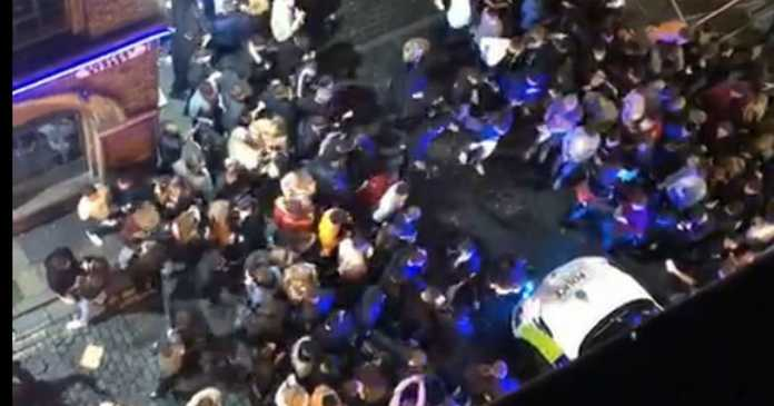 Large crowd attacks police car in Liverpool after last orders before lockdown
