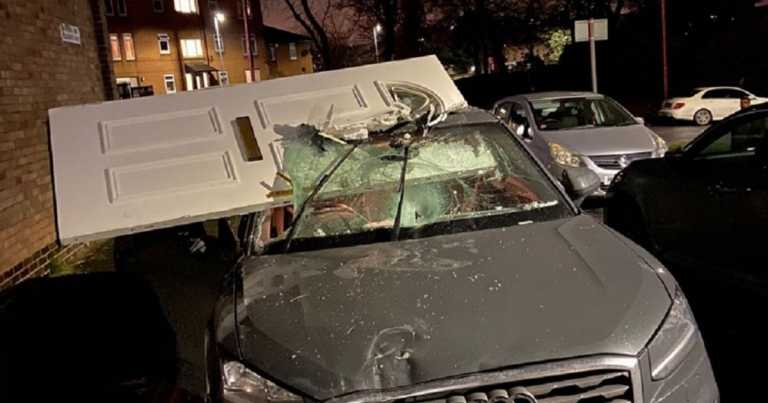 Car driven with front door in windscreen after crashing into house