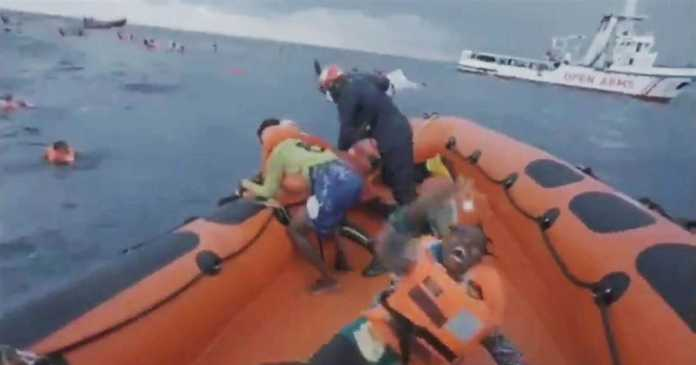 Desperate mother screams, 'Where's my baby?' as migrant dinghy sinks off Libya