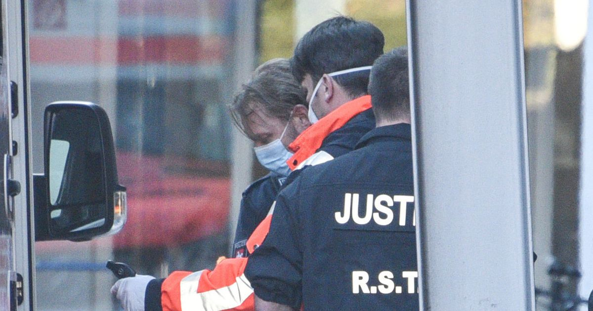 Maddie McCann suspect Christian Brueckner pictured in chains on way to hospital