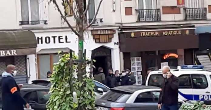 Man 'armed with machete barricaded in Paris building' as police surround scene
