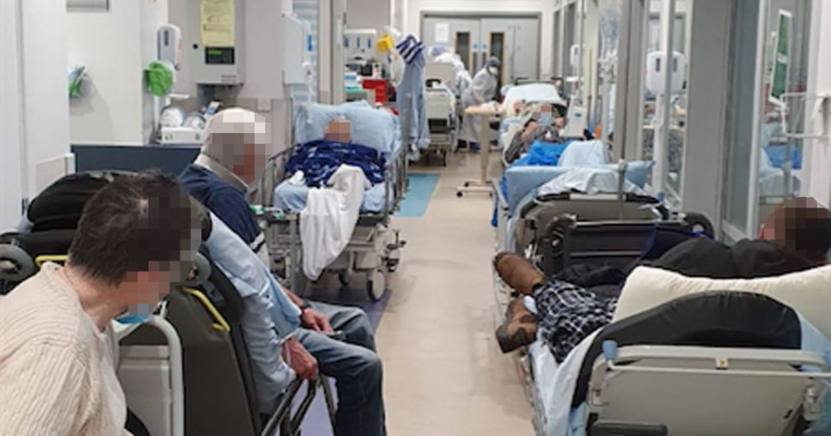 Heartbreaking photos show patients lined up on trolleys at Covid-hit hospital