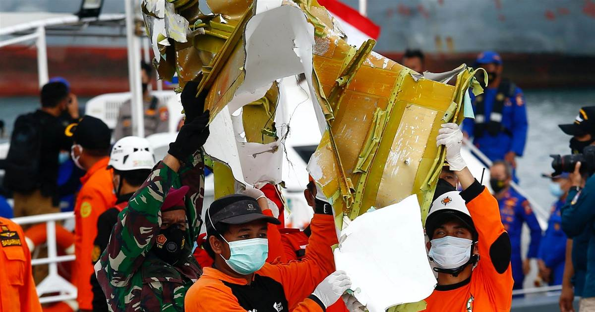 Plane wreckage and human remains recovered from Indonesia crash site