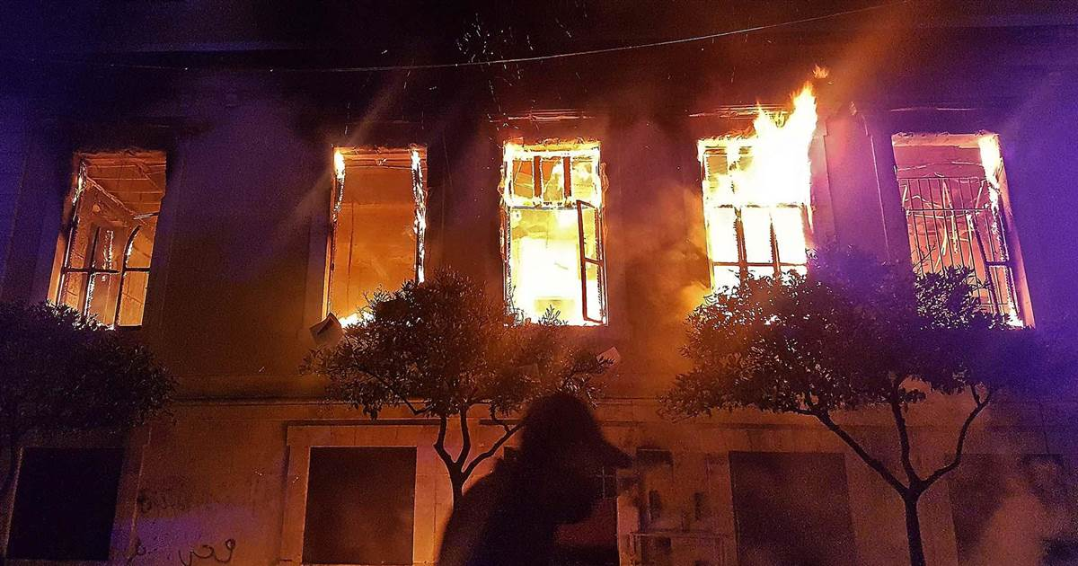 Protesters torch government building over Covid curfew in Lebanon