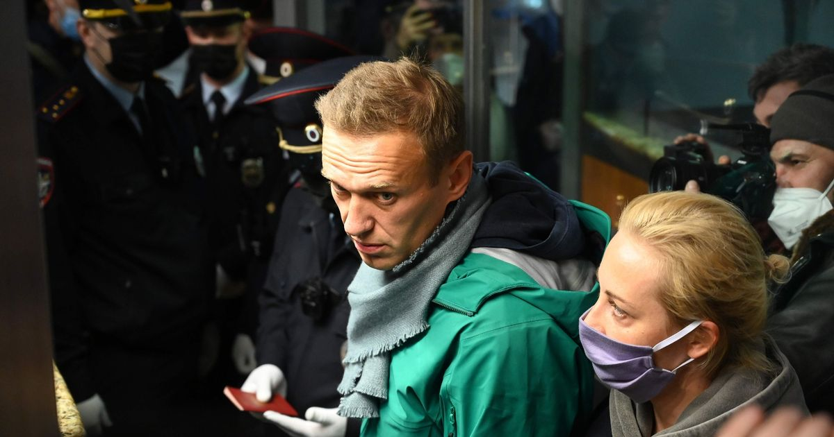 Putin critic Alexei Navalny jailed hours after Moscow return following poisoning