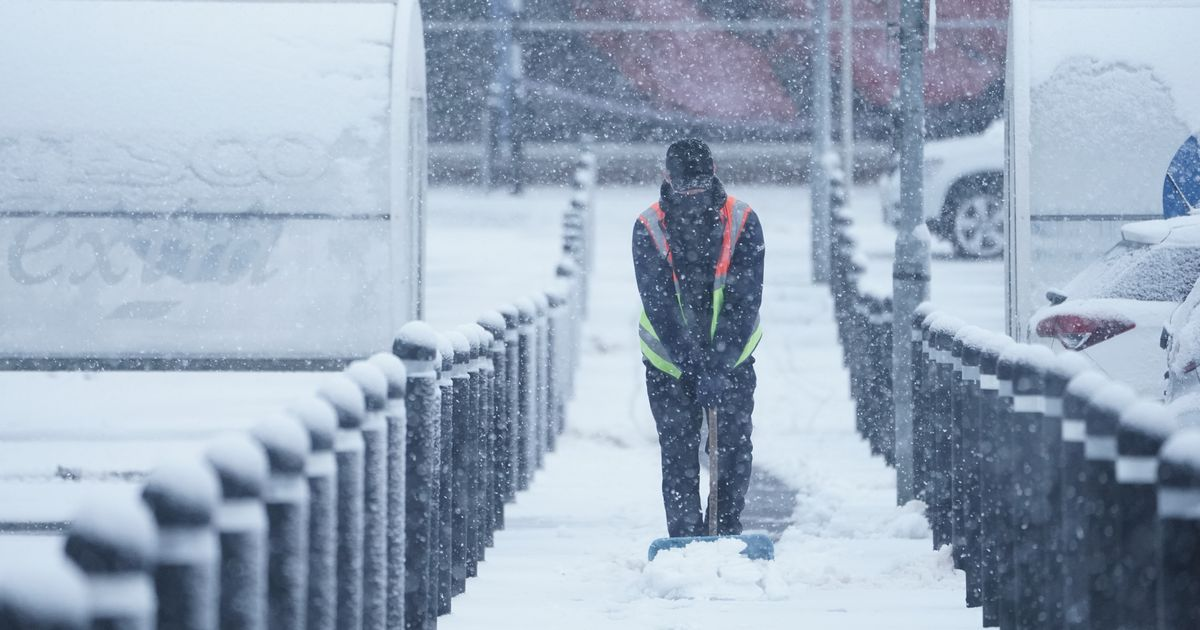 Vaccinations postponed as heavy snow and freezing rain batter UK