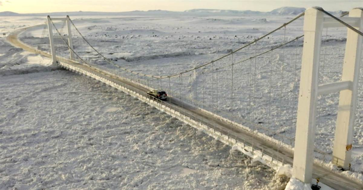Icebound river threatens highway, bridge as deep freeze strikes