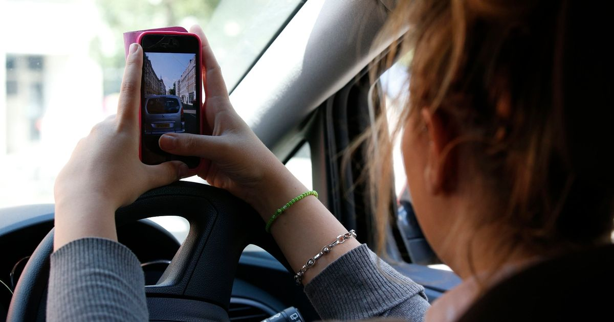 Lawyer warns ban on holding phone in car could make roads less safe