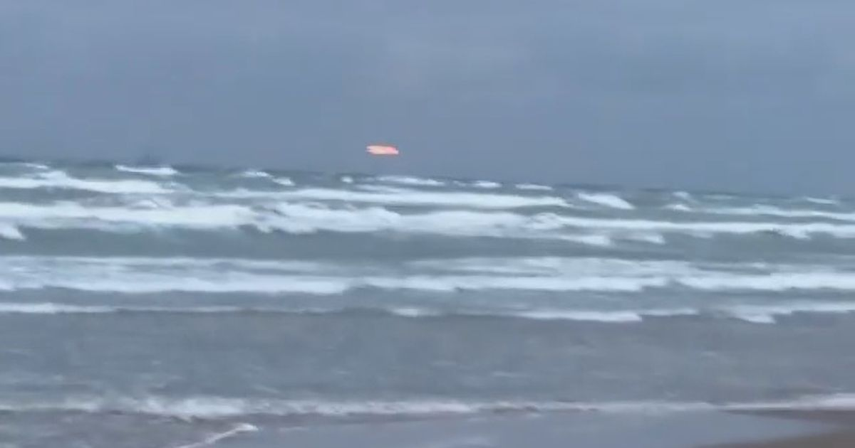 Mysterious glowing 'UFO' spotted hovering in sky by beach jogger on morning run
