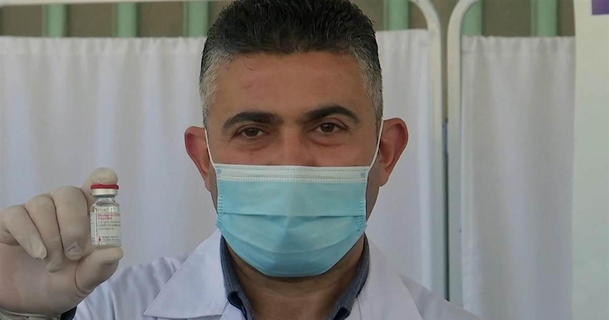Palestinian healthcare workers react to the status of COVID vaccination rollout