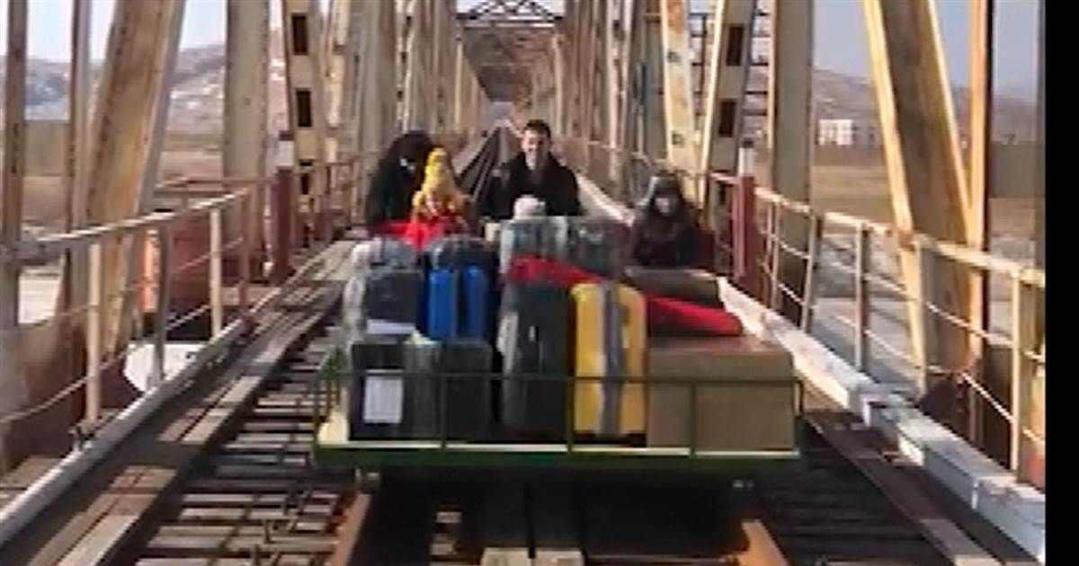 Watch: Russians push railcar with kids, luggage to leave North Korea