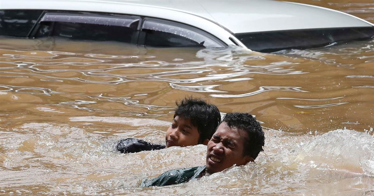 Watch: Stranded residents rescued as floods hit Jakarta