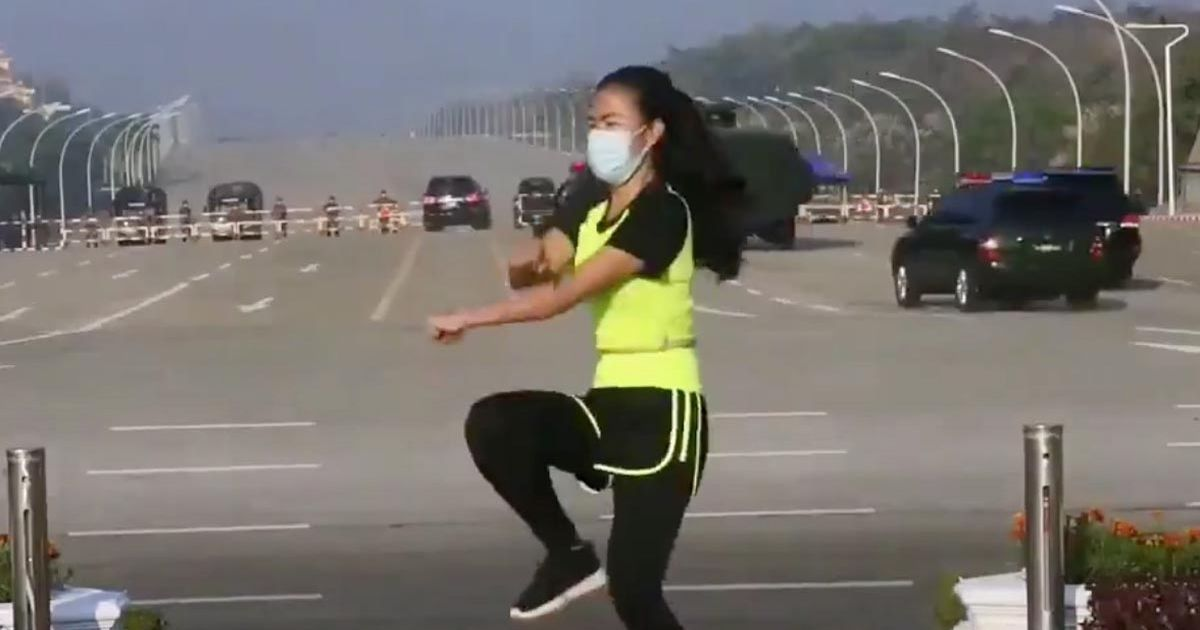 Woman films virtual aerobics class unaware of military coup developing behind