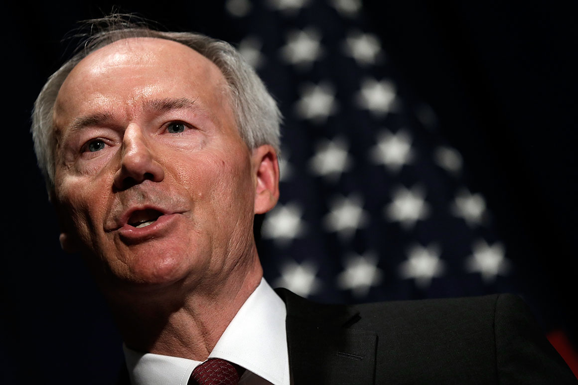 Arkansas governor signs near-total abortion ban into law