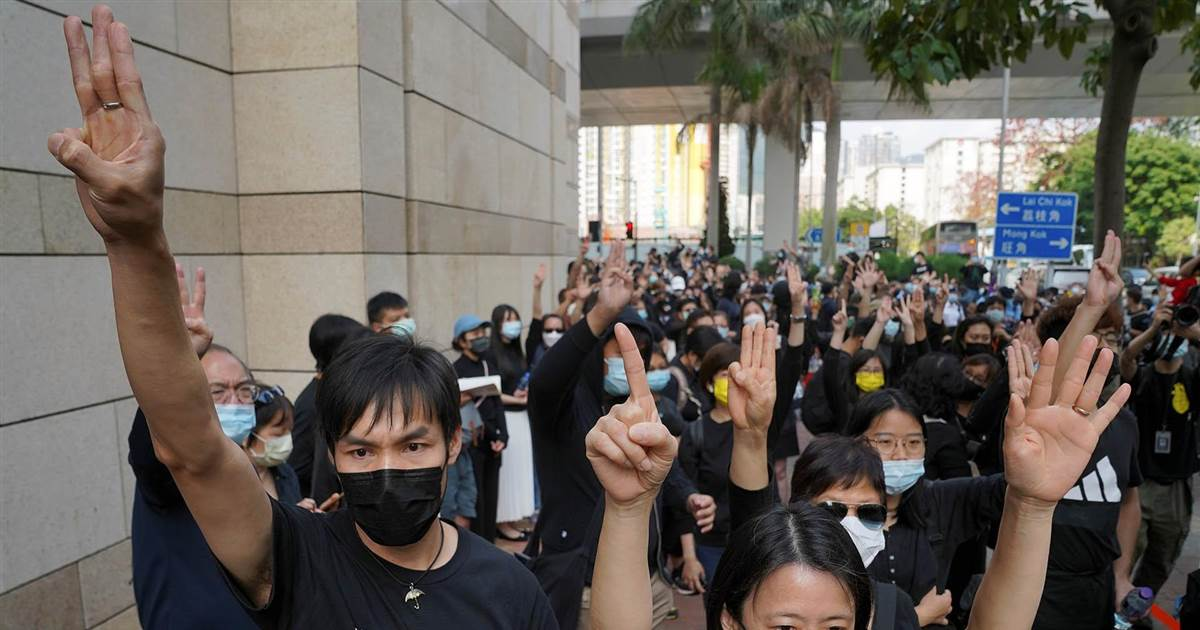 Hong Kong protesters defiant as pro-democracy activists appear in court