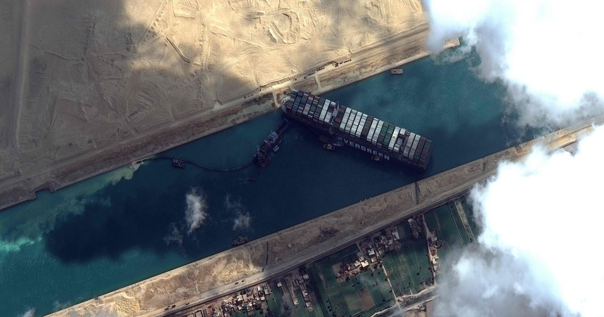 Huge container ship veered wildly 'in gust of wind' before Suez Canal crash