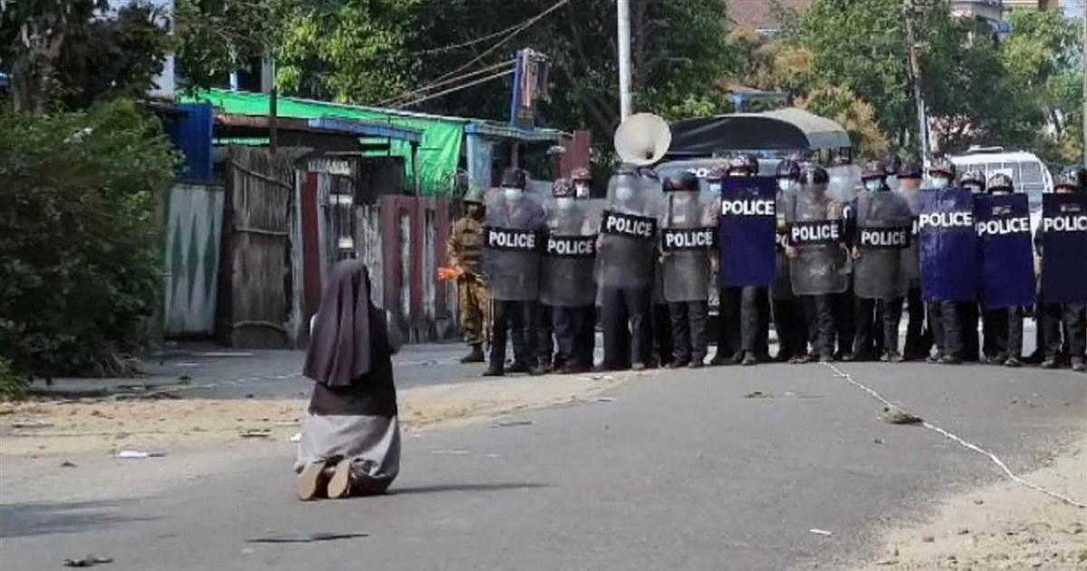 Myanmar nun stands between police and protesters
