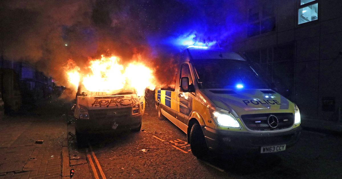 Police van set alight after demonstration over protest powers turns violent