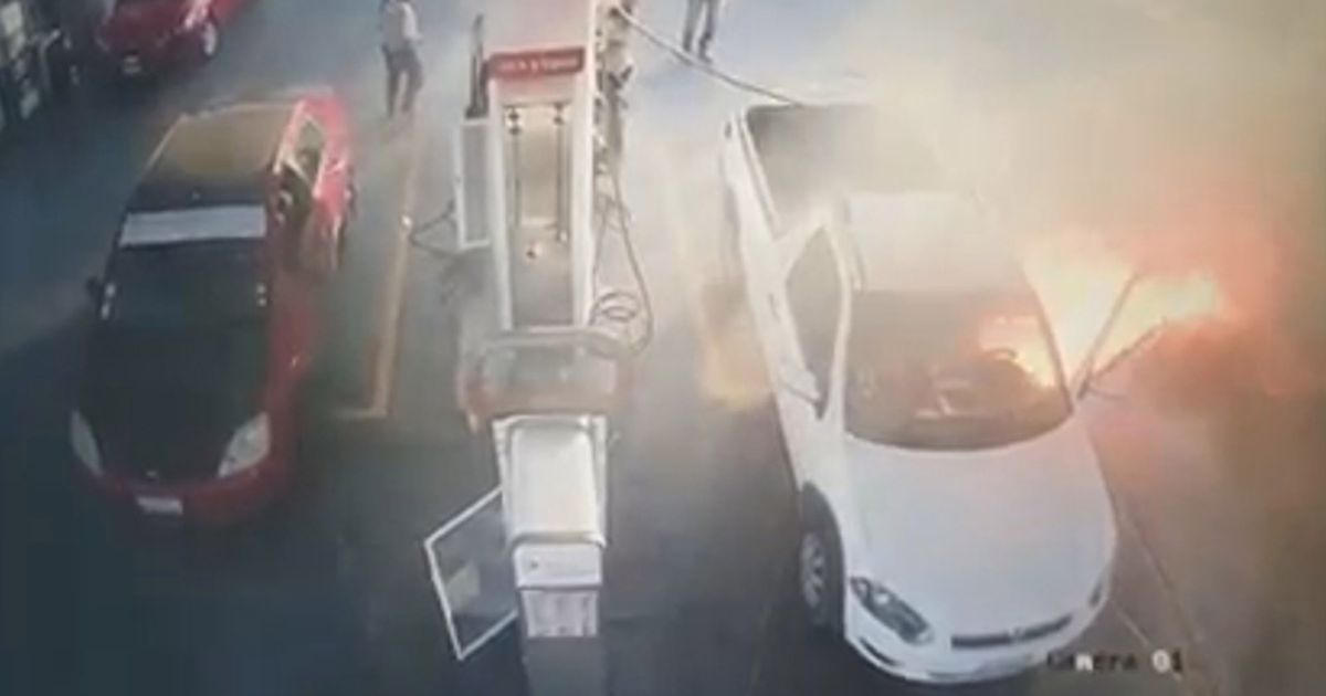 Van bursts into flames as driver fills petrol tank while using mobile phone