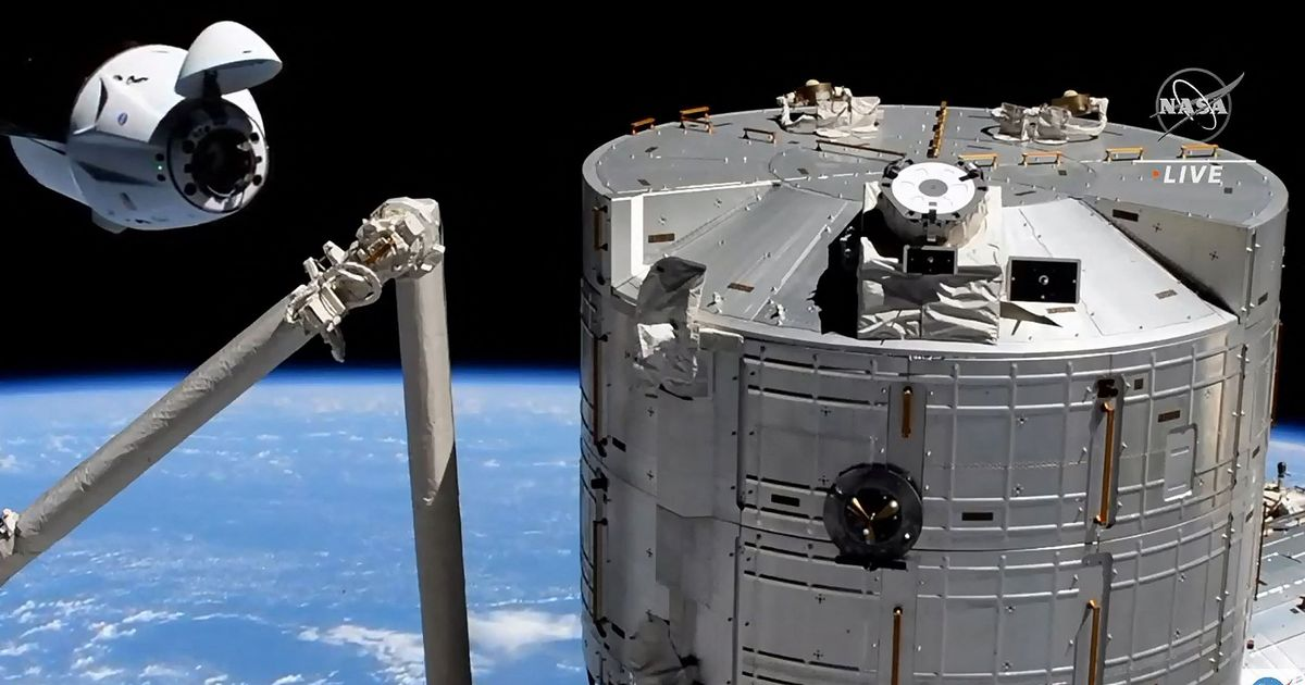 Astronauts on SpaceX's Crew Dragon capsule arrive at International Space Station