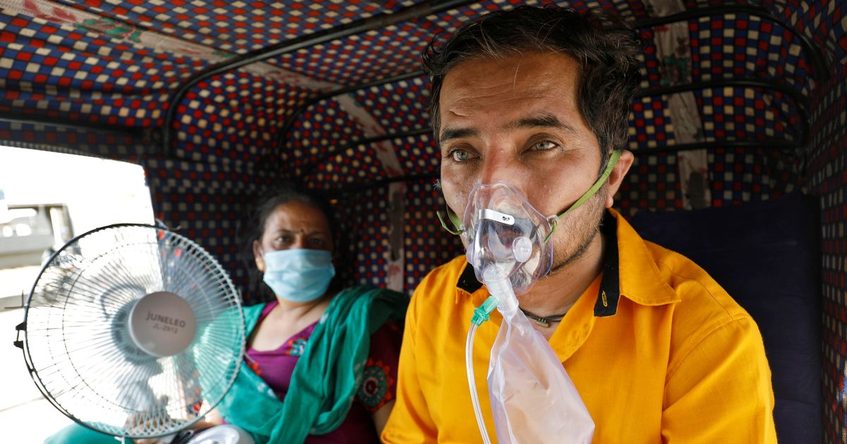 Families beg and barter for air as India's Covid crisis sees a hunt for oxygen