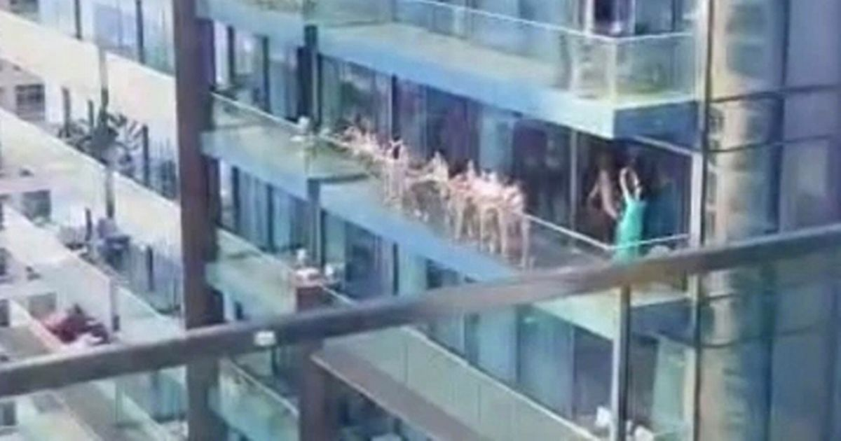 Group of women arrested after stripping naked to pose on a balcony