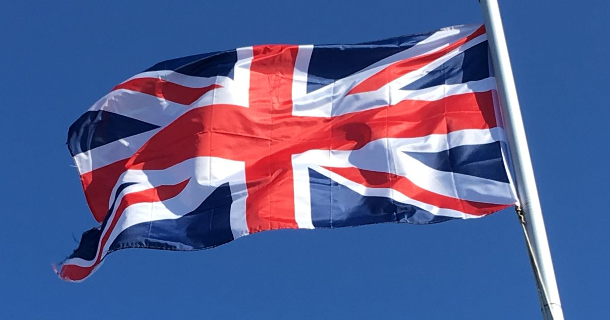 Headteacher agrees to take down Union flag after protests