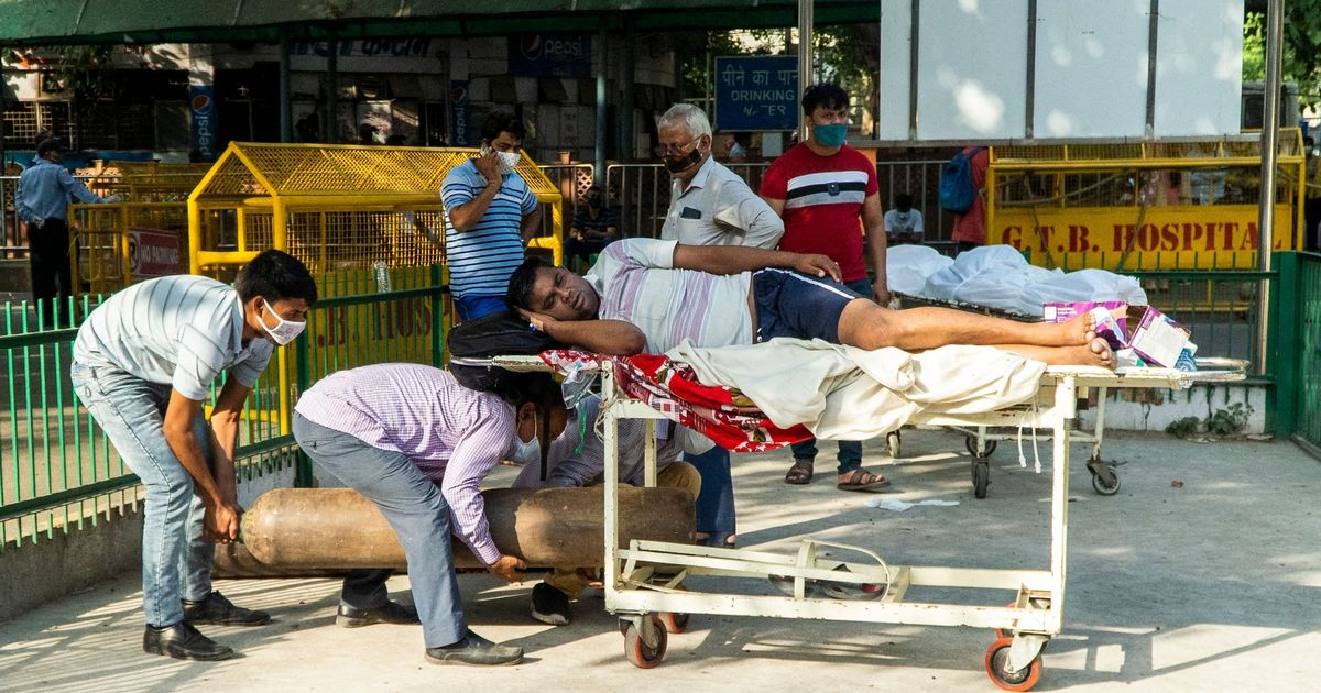 India's Covid 'tsunami' as hospitals run out of oxygen and people die in street