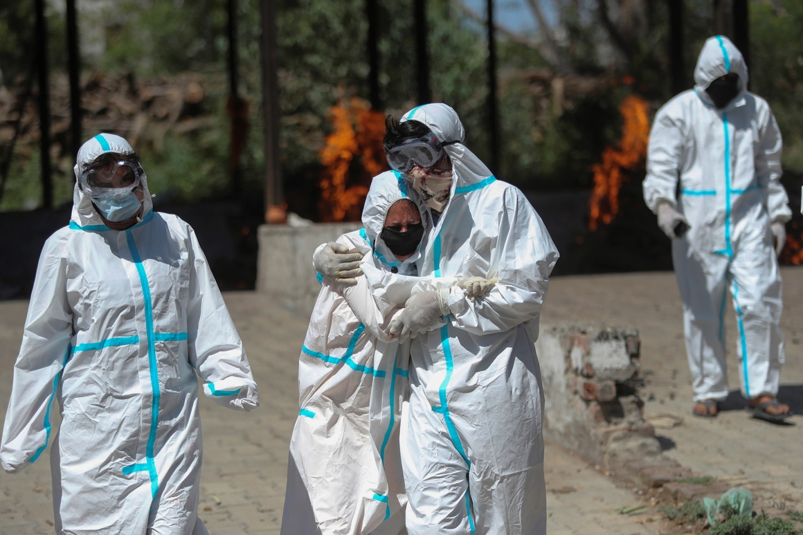 India's crematoriums overwhelmed as virus 'swallows people'