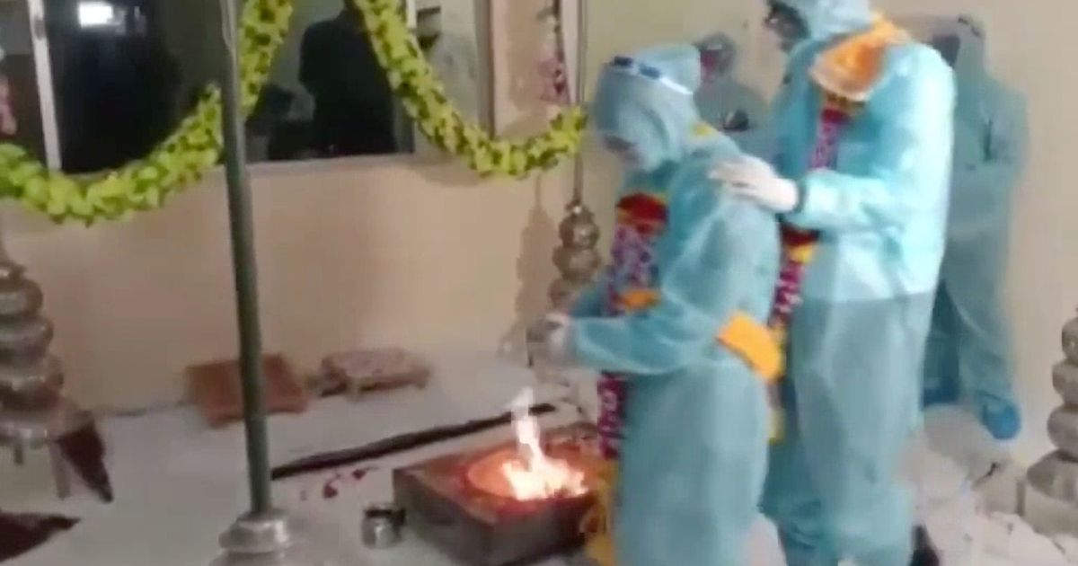 Indian couple tie the knot in full PPE after groom tests positive for Covid